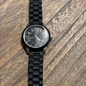 Ladies large faced black band watch
